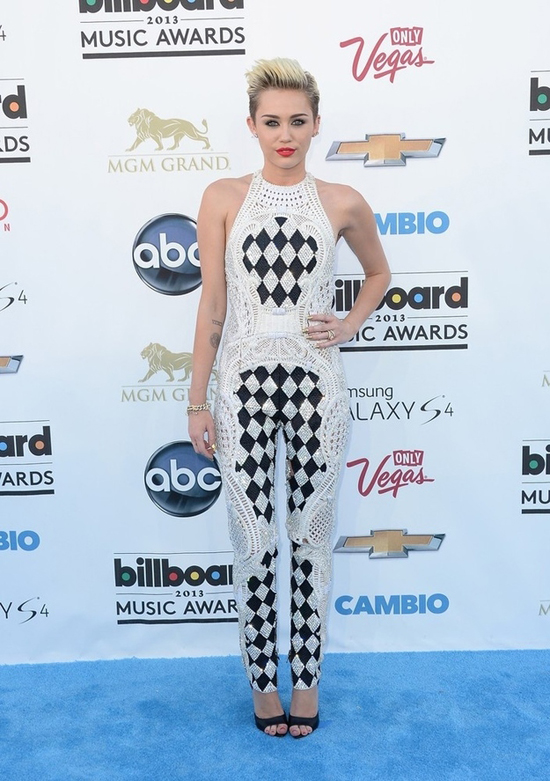 Miley Cyrus: yes, she may remind everyone of a court jester, but hey...she looks damn good as one.