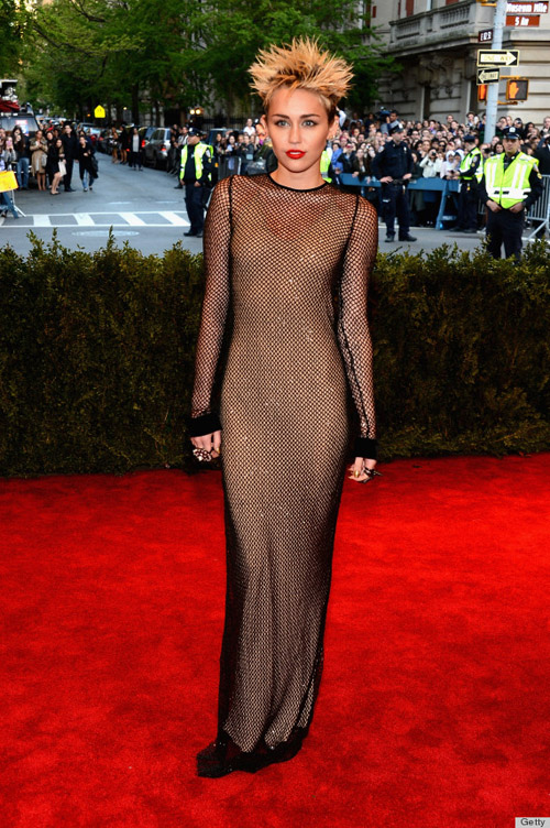 Miley Cyrus: Slinky mesh dress? Check. Spiky hair? Check. No bra? Double check. Miley rocked it, no matter what the haters say. GET IT GIRL.